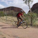 A biker riding inside West MacDonnell National Park